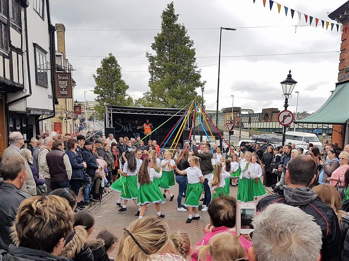 Girls dancing around the maypole on May Day, Sweeps Festival Rochester 2017