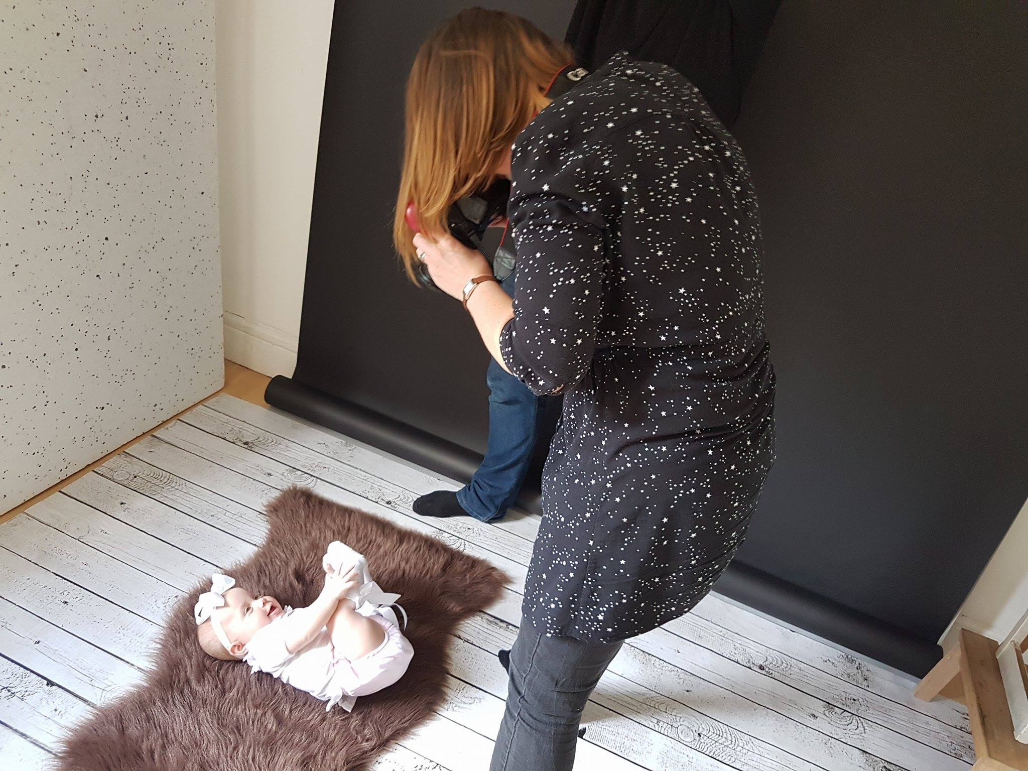 Autumn having her photo taken on a fur rug at Love Lane Photography