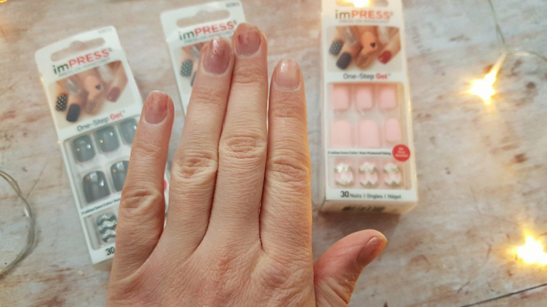 Hard working mum hands with worn off nail varnish