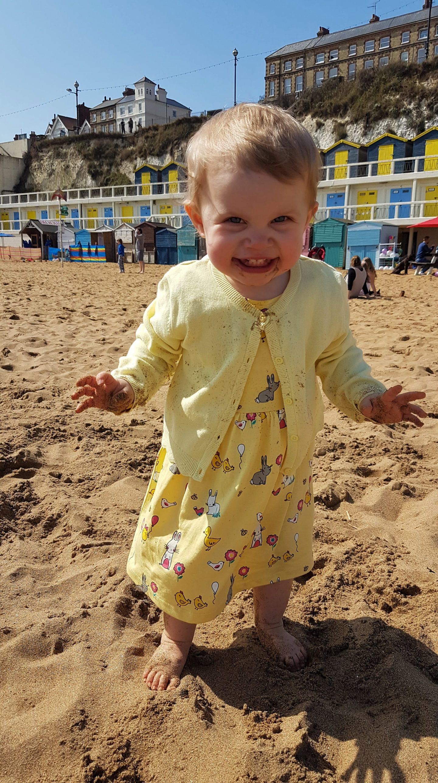 Toddler dancing on beach at Broadstairs
