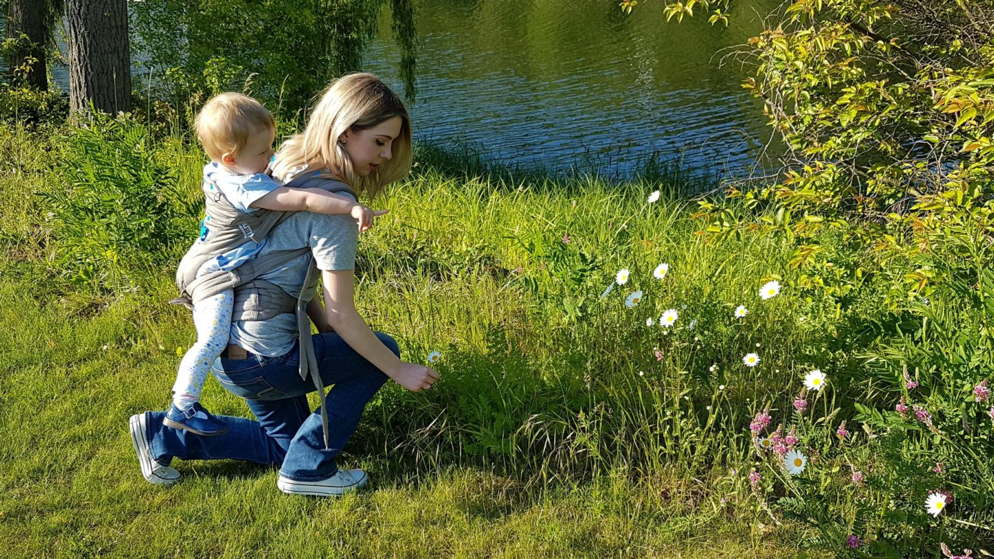 Baby wearing by a lake with the Pao Papoose