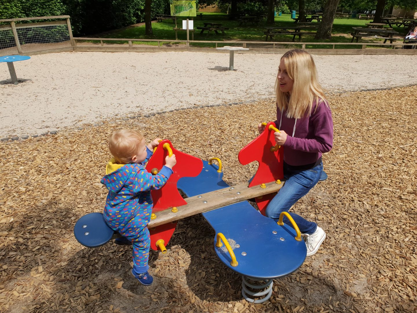 Autumn and Mummy on the seesaw at Howletts in Canterbury, Kent