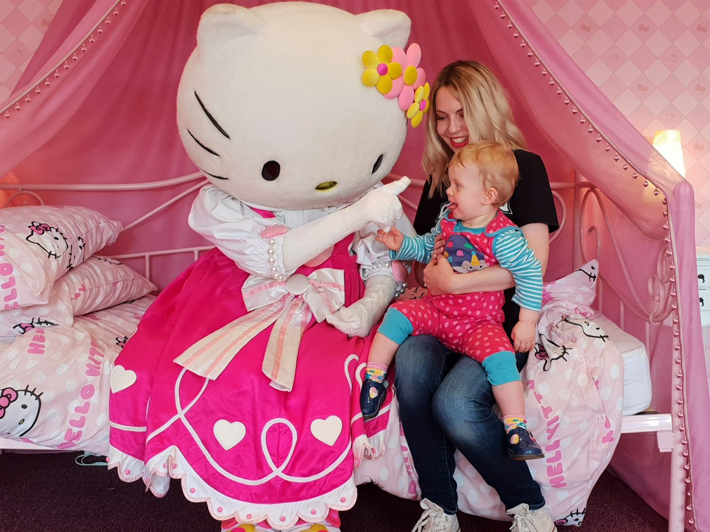 Hello Kitty tickling toddler's chin at Drusillas Park