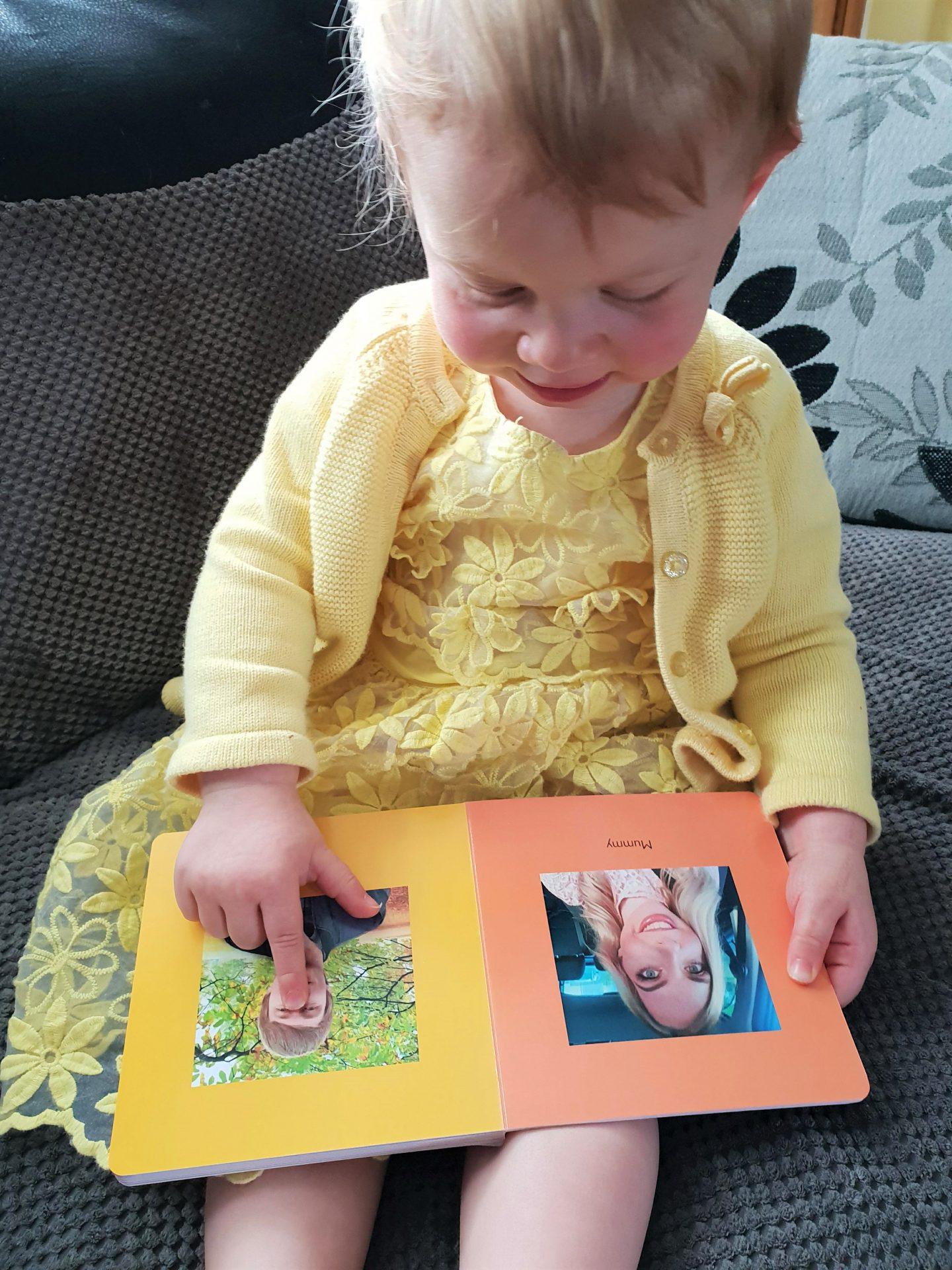 Autumn looking at parents in first photo book