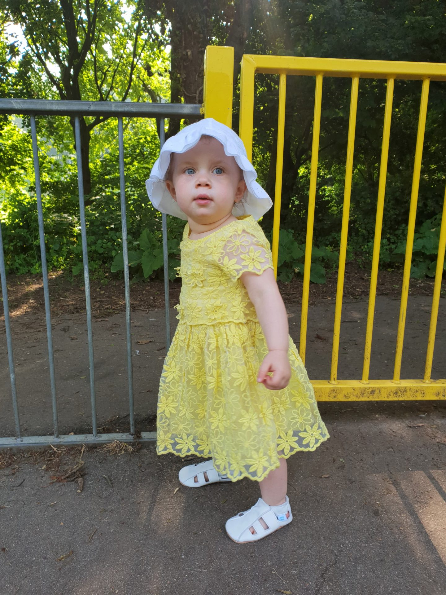 Toddler in soft soled white sandals from Dotty Fish