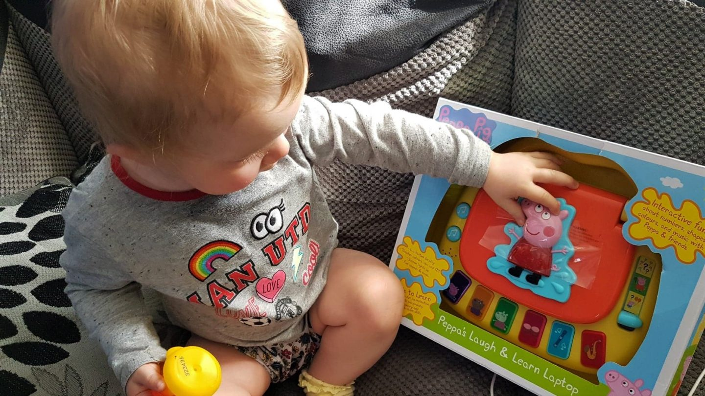 Toddler with Peppa Pig Laugh and Learn Laptop in box