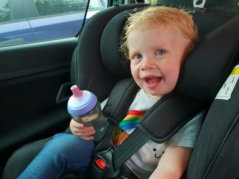 Toddler in Axkid Minikid rear facing car seat