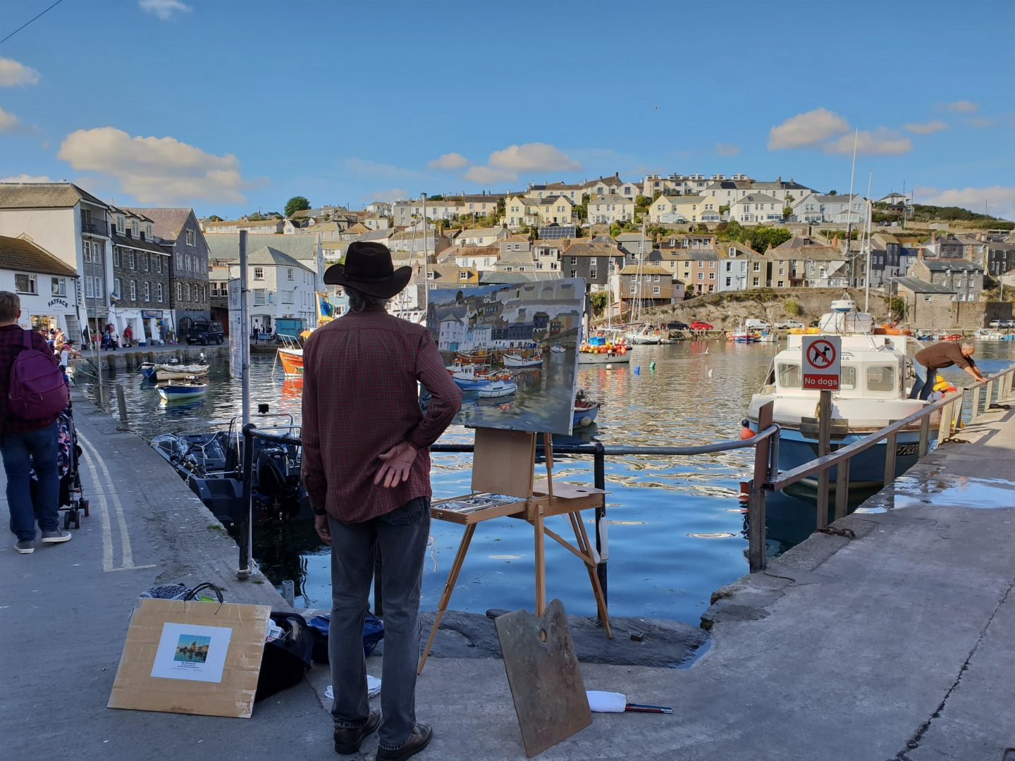 Artist painting at Mevagissey harbour