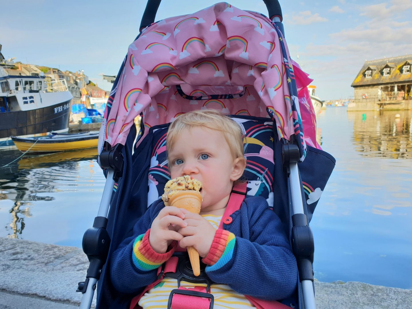 Toddler eating ice cream in Mevagissey