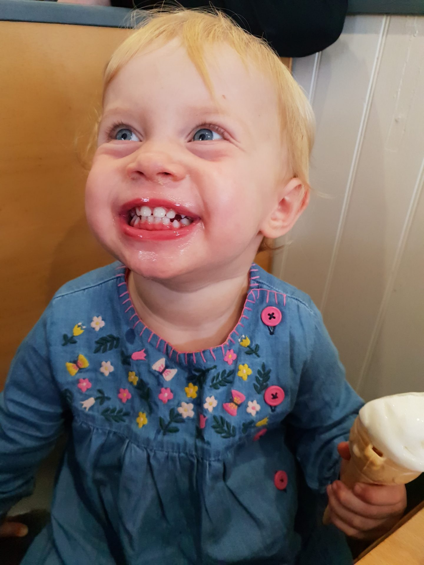 Toddler smiling after Moomaid of Zennor ice cream at St. Ives, Cornwall