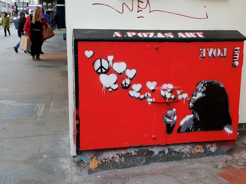 Box street art graffiti peace hearts kiss Brighton