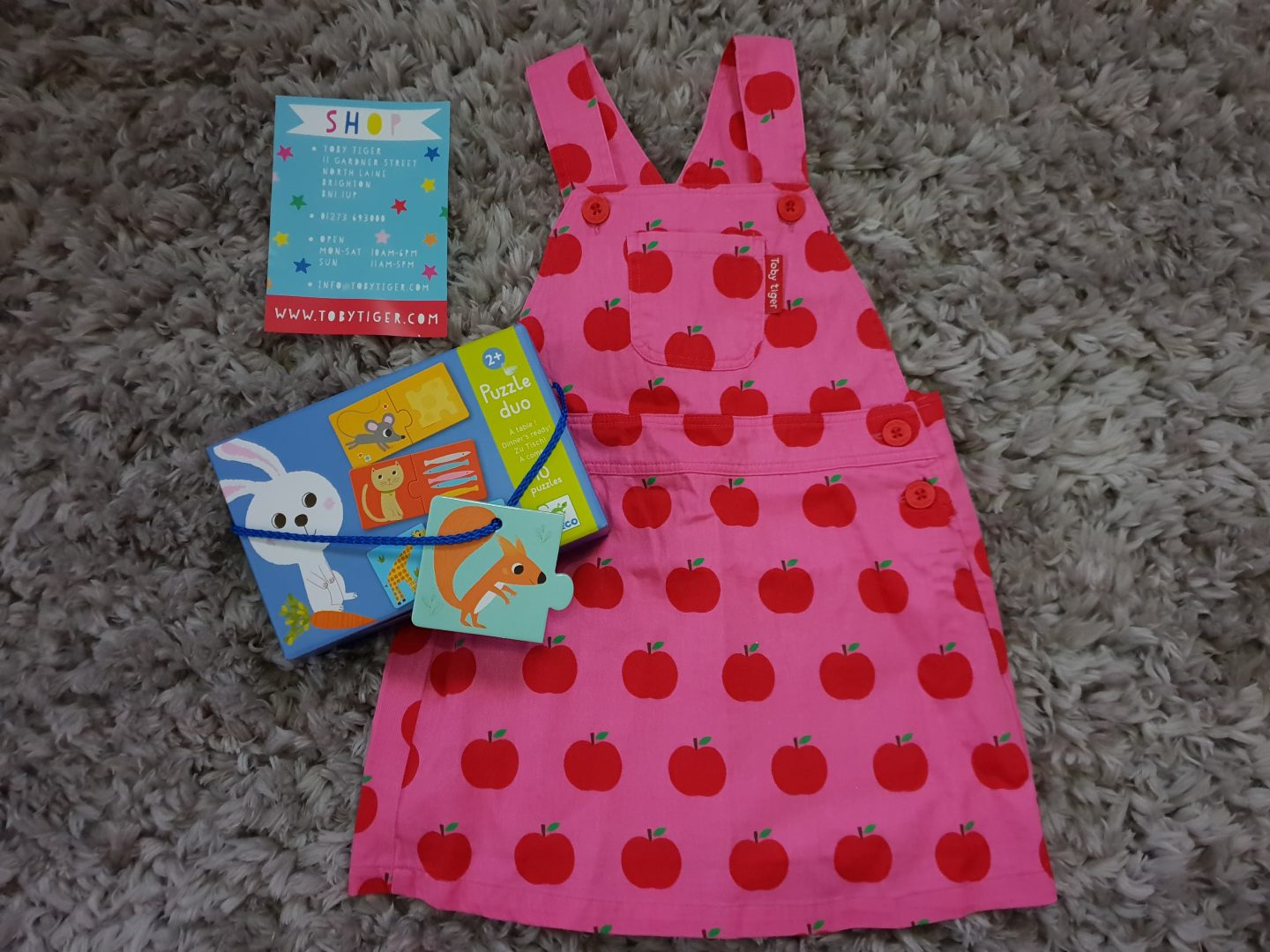 Toby Tiger pink apple print dungaree dress and puzzle