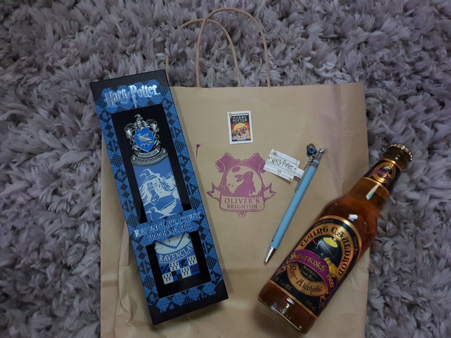 Ravenclaw bookmark, Ravenclaw pen, Butterscotch Beer and Harry Potter 2005 stamp from Oliver's Brighton
