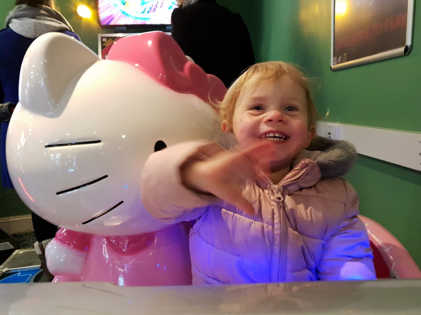 Toddler on Hello Kitty car ride on Brighton Palace Pier