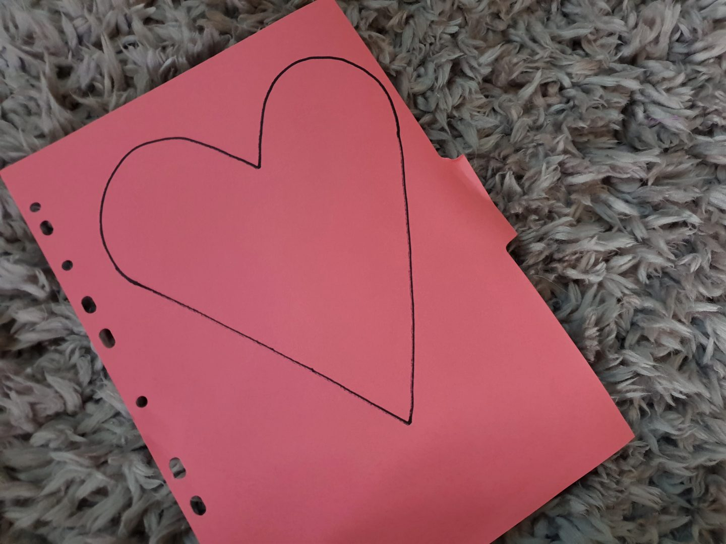 Heart shape drawn with sharpie on recycled pink card