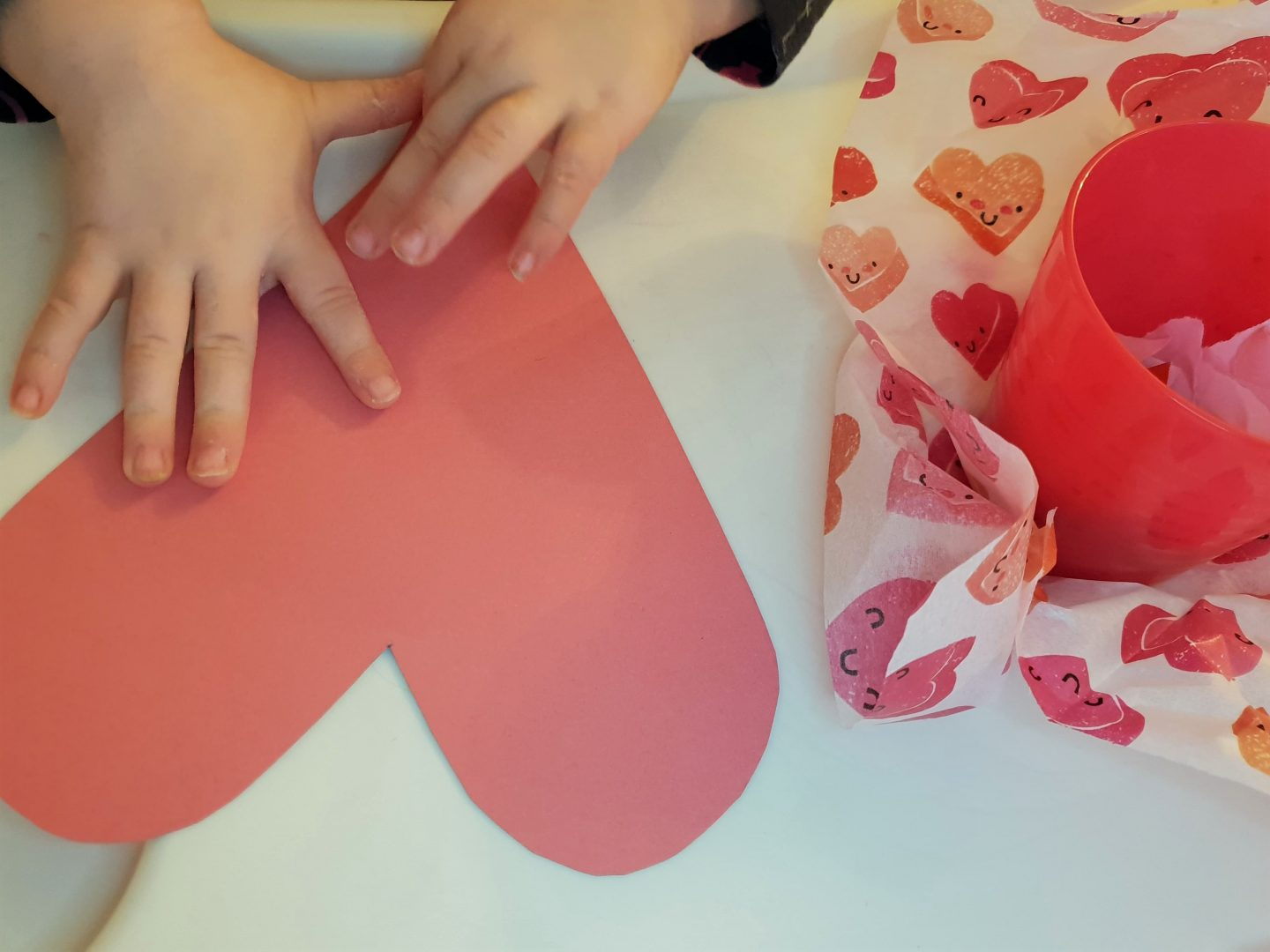 Pink heart shape cut out for preschooler Valentine's Day craft