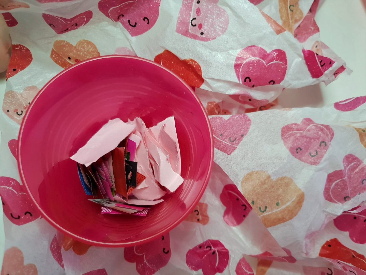 Pot of pink and red scrap paper for Valentine's Day toddler craft