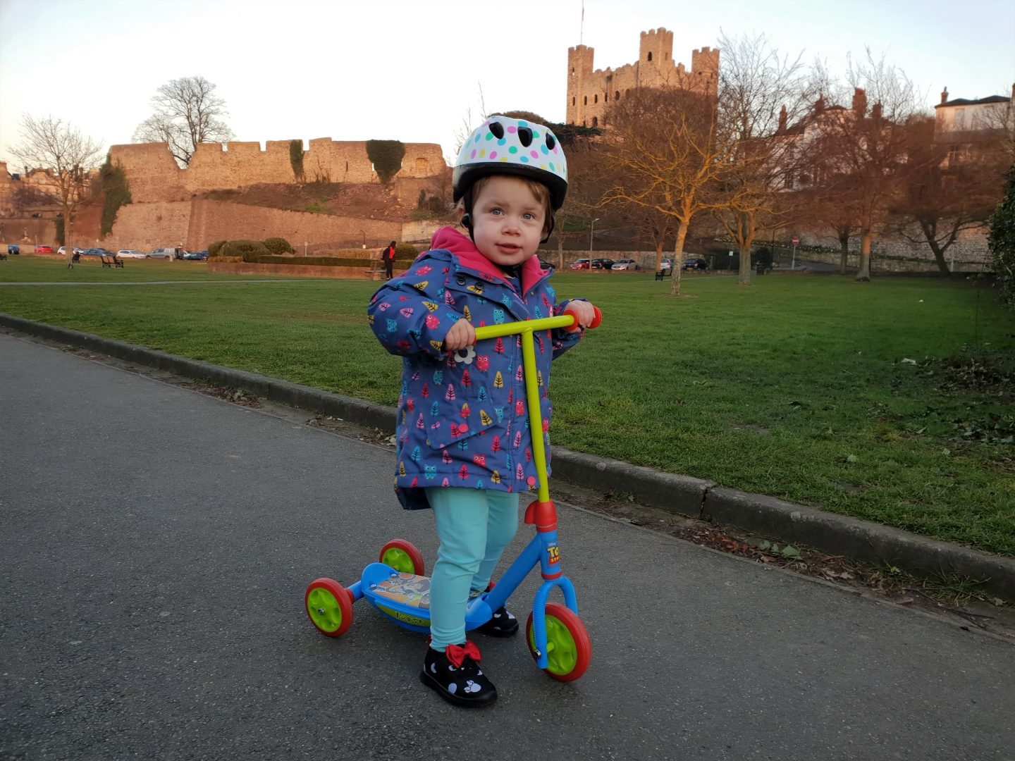 Toddler on Toy Story scooter