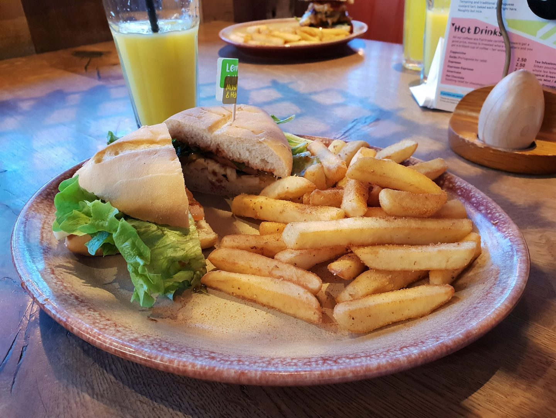 Nando's halloumi and portobello mushroom burger with peri peri fries and orange juice