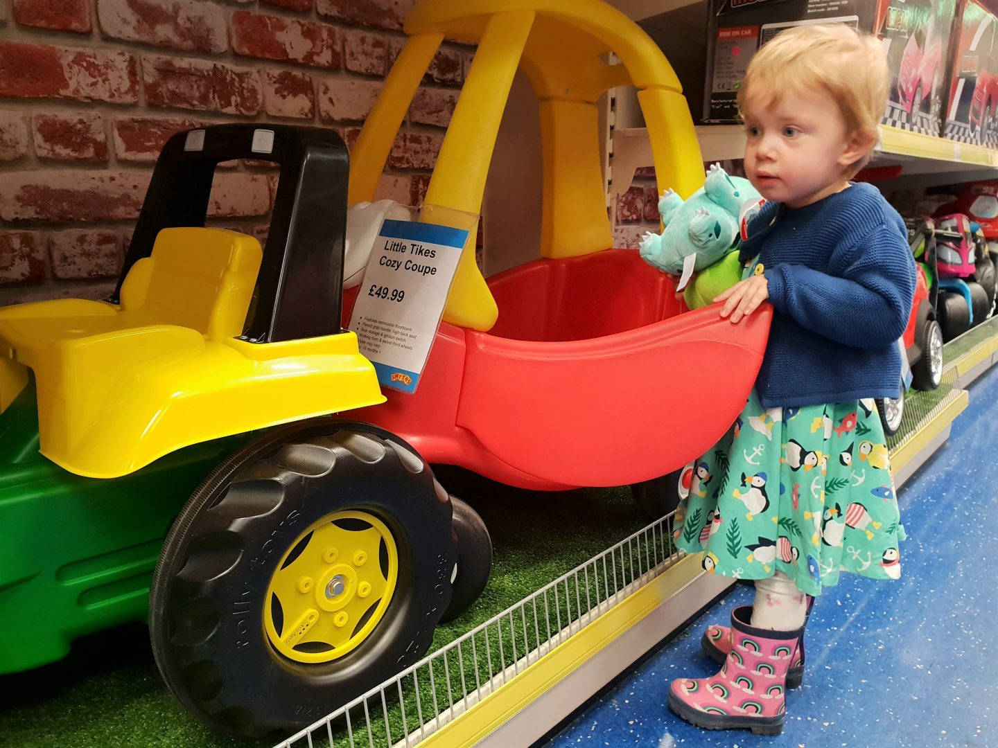 Toddler looking at toy car in Smyths Toys, South Aylesford Retail Park