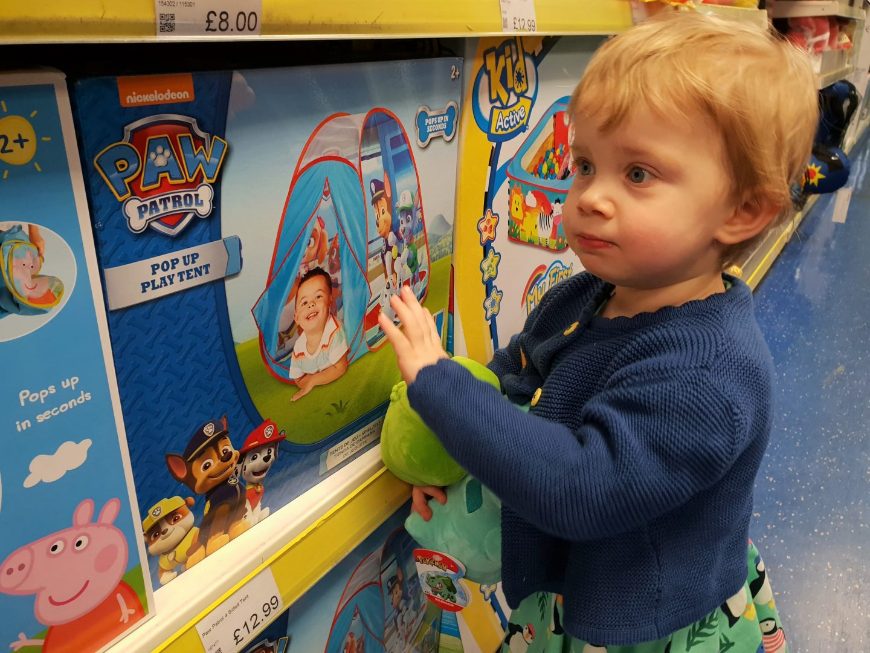 Toddler looking at Paw Patrol tent at South Aylesford Retail Park