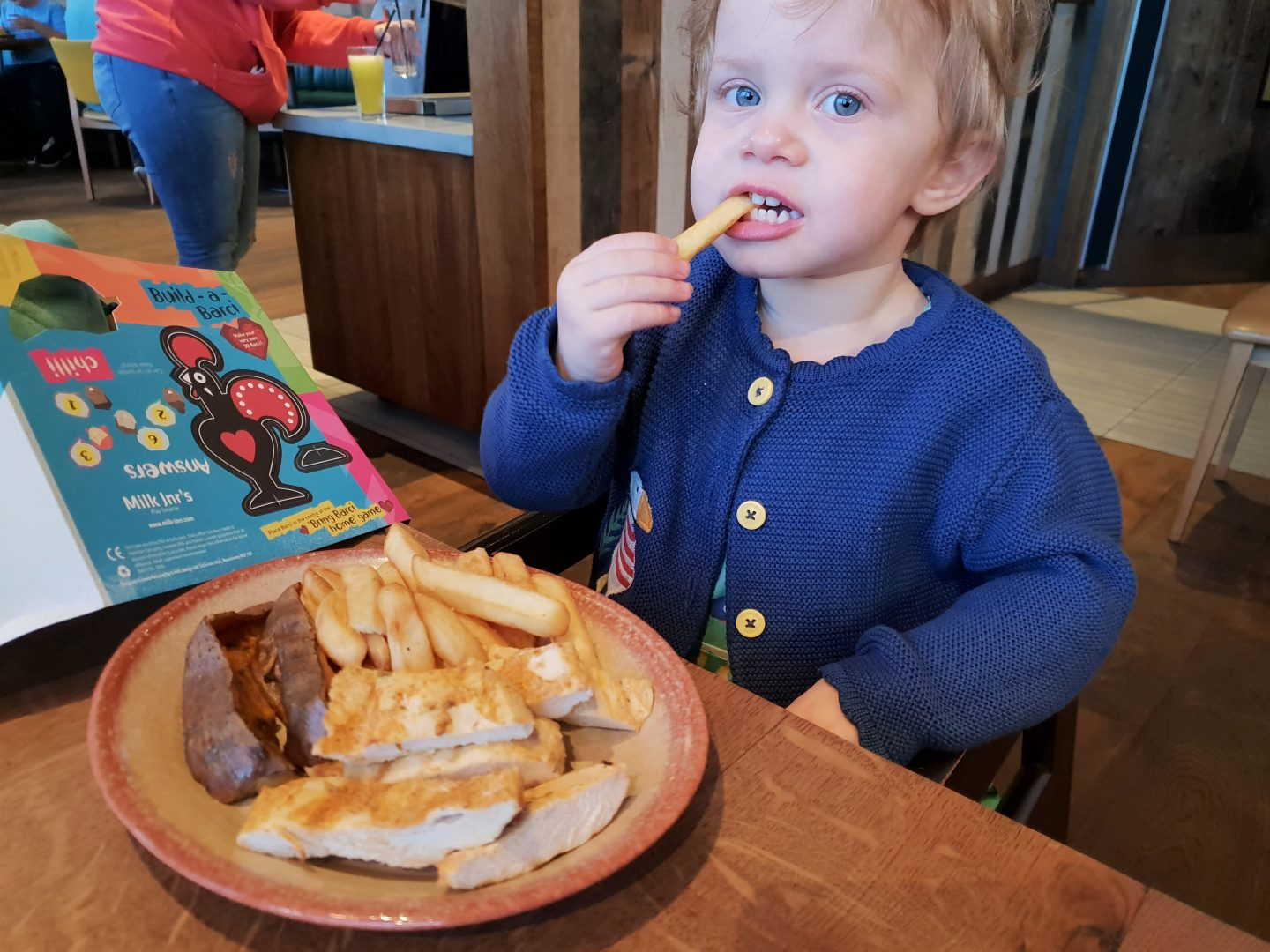 Toddler with Nandinos chicken strips, chips and sweet potato at Nando's, South Aylesford Retail Park