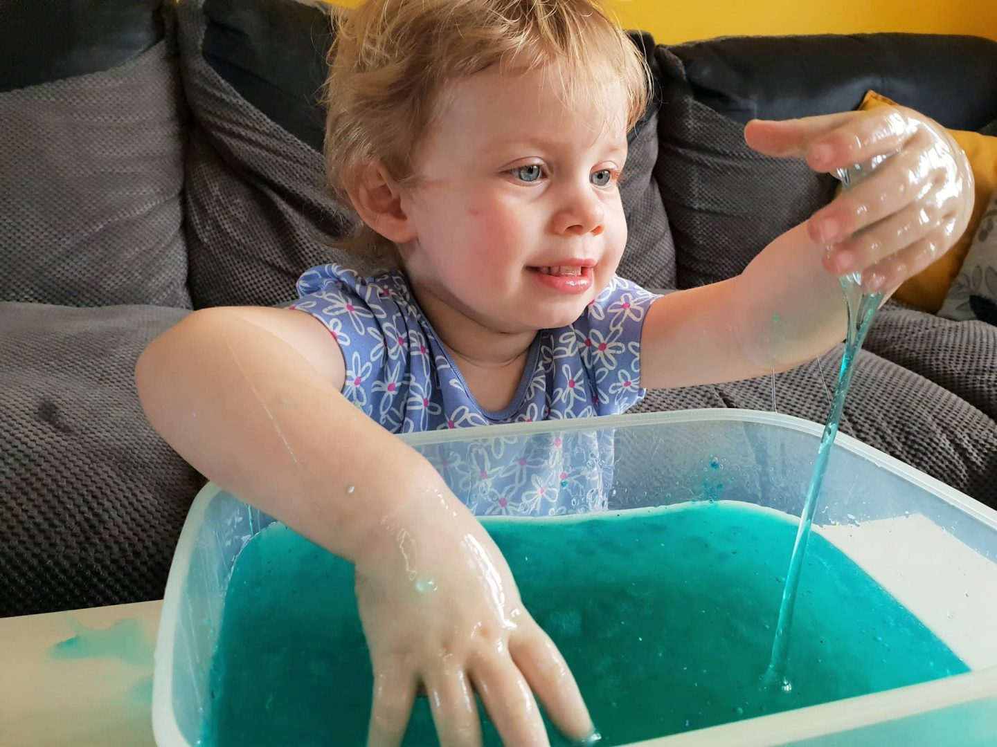 Toddler watching string of slime