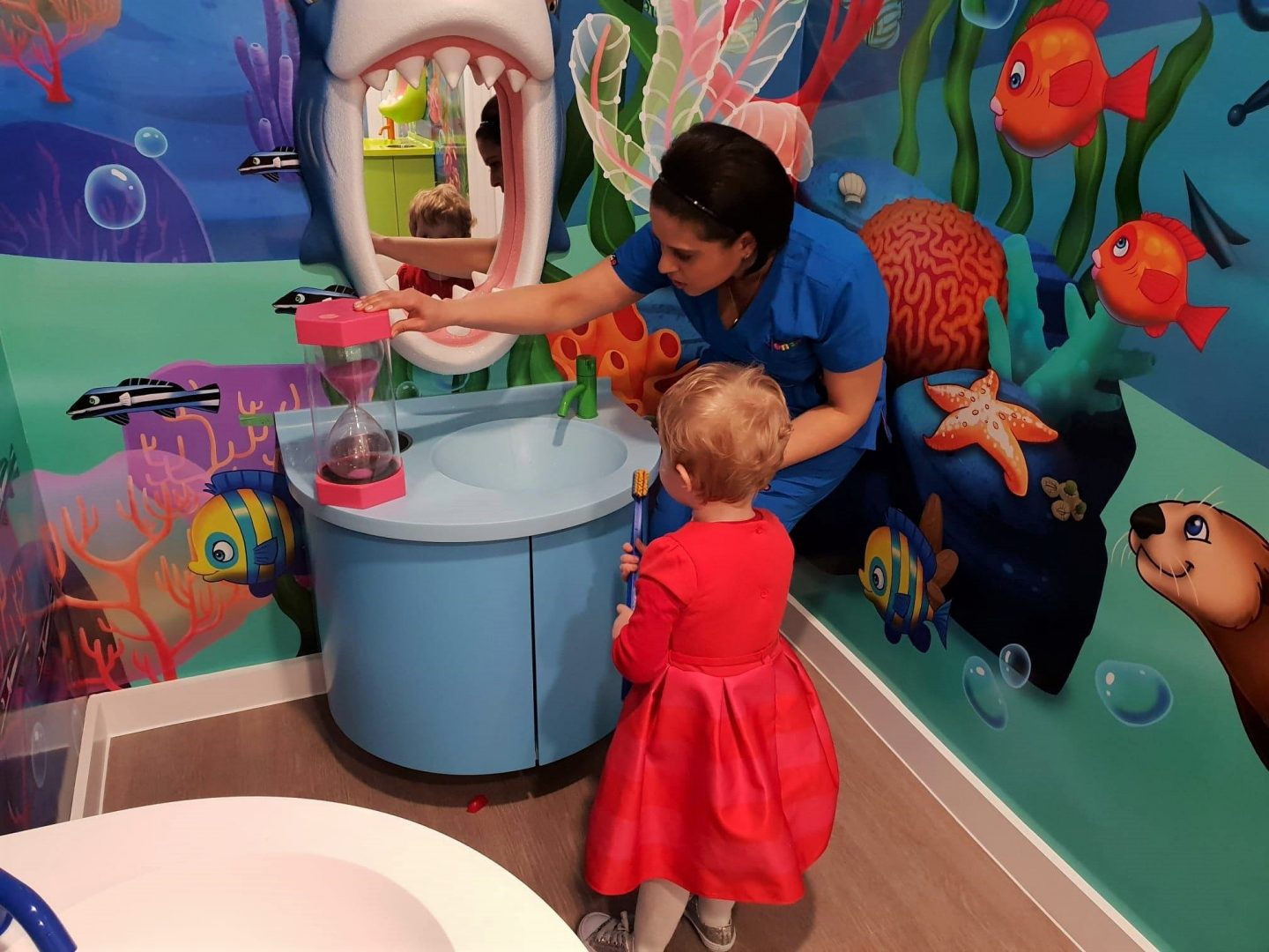 Dr Tooth Fairy at Happy Kids Dental, Chelsea showing how to brush teeth