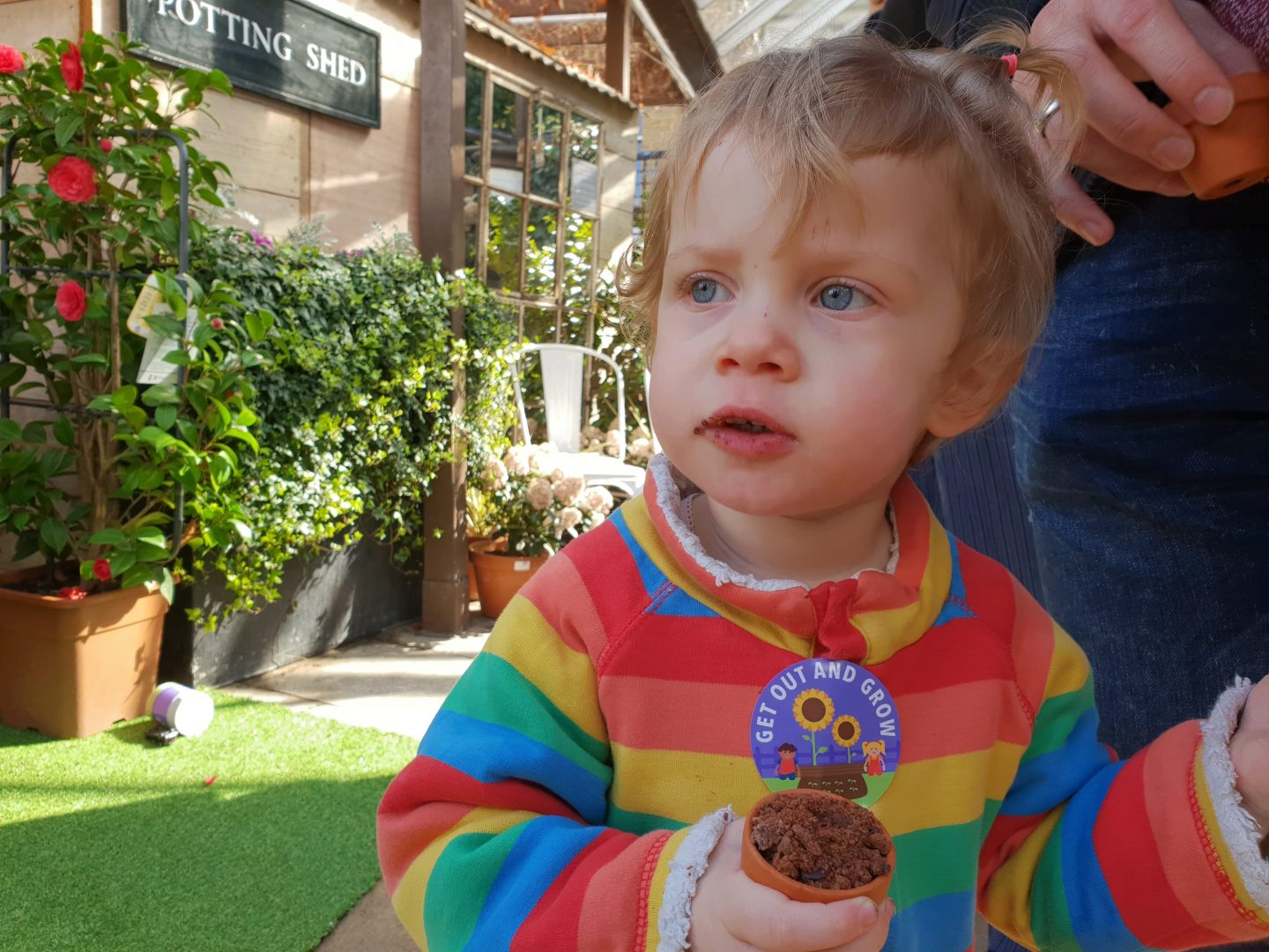 Toddler with plant pot cake at Get Out and Grow launch