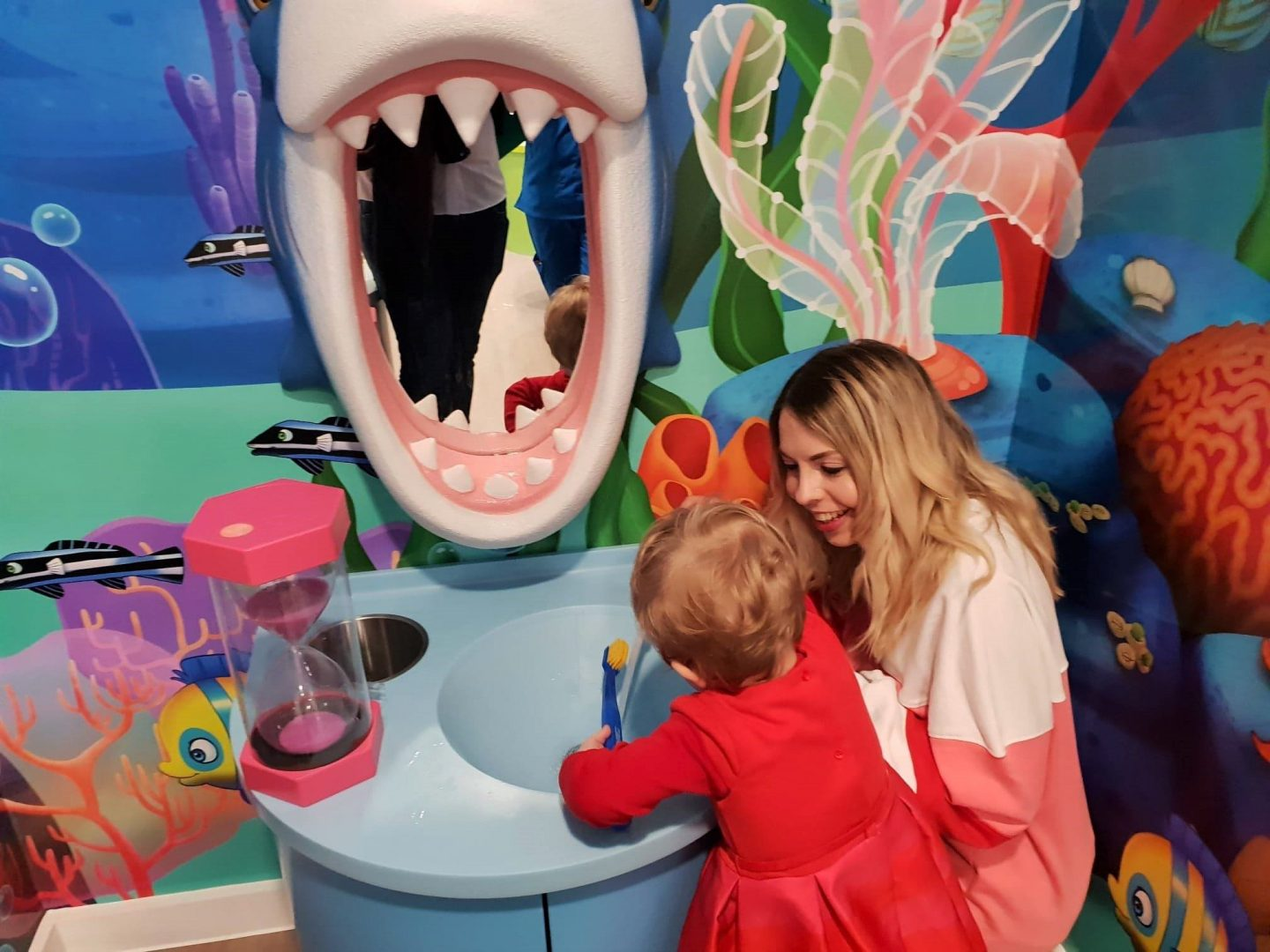 Toddler brushing shark teeth at Happy Kids Dental, Chelsea