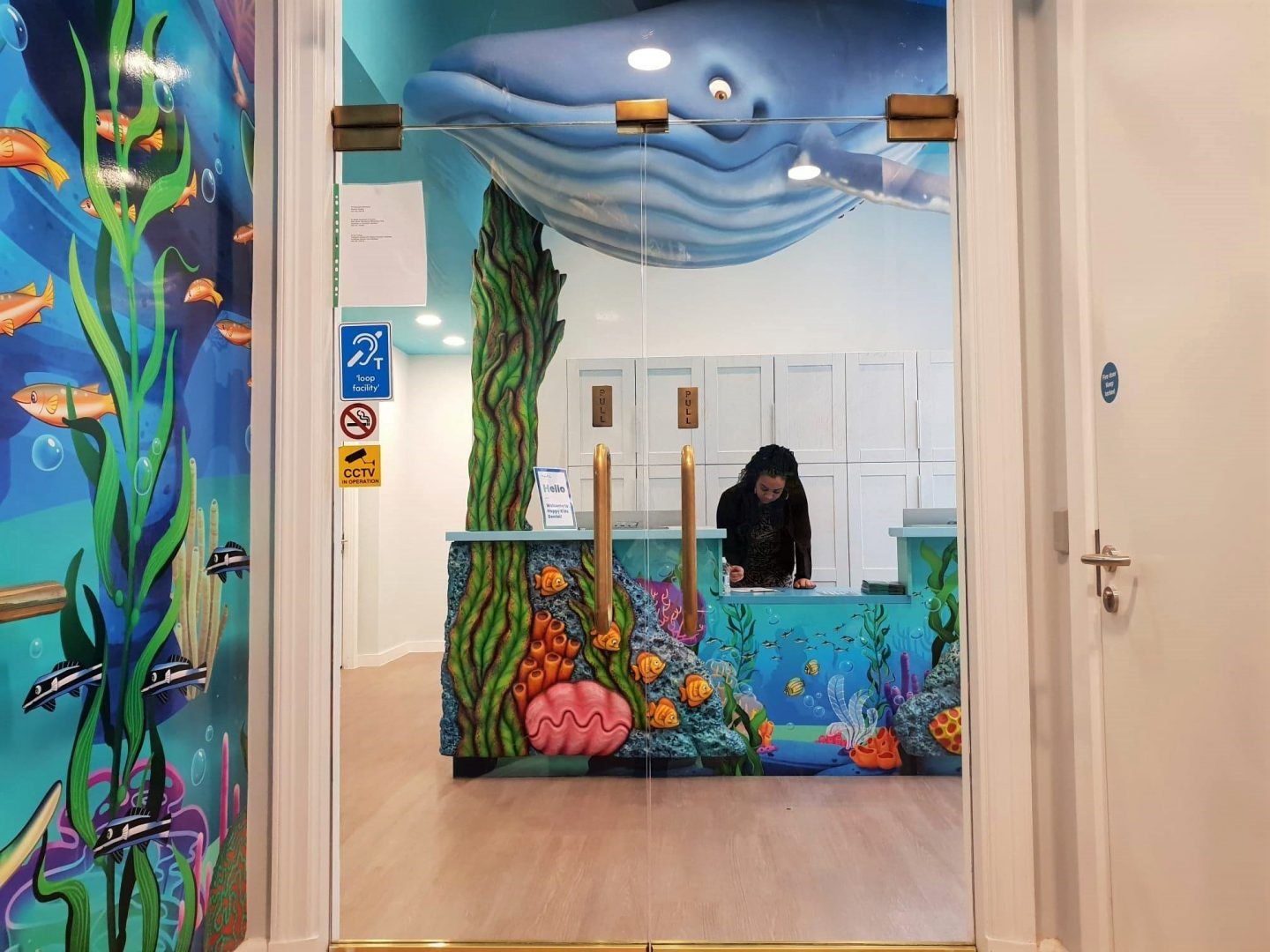 Reception desk and whale entrance at Happy Kids Dental, Chelsea