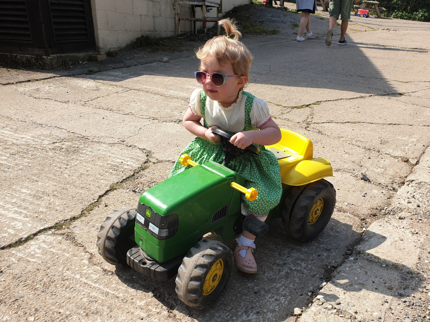 Toddler on toy tractor