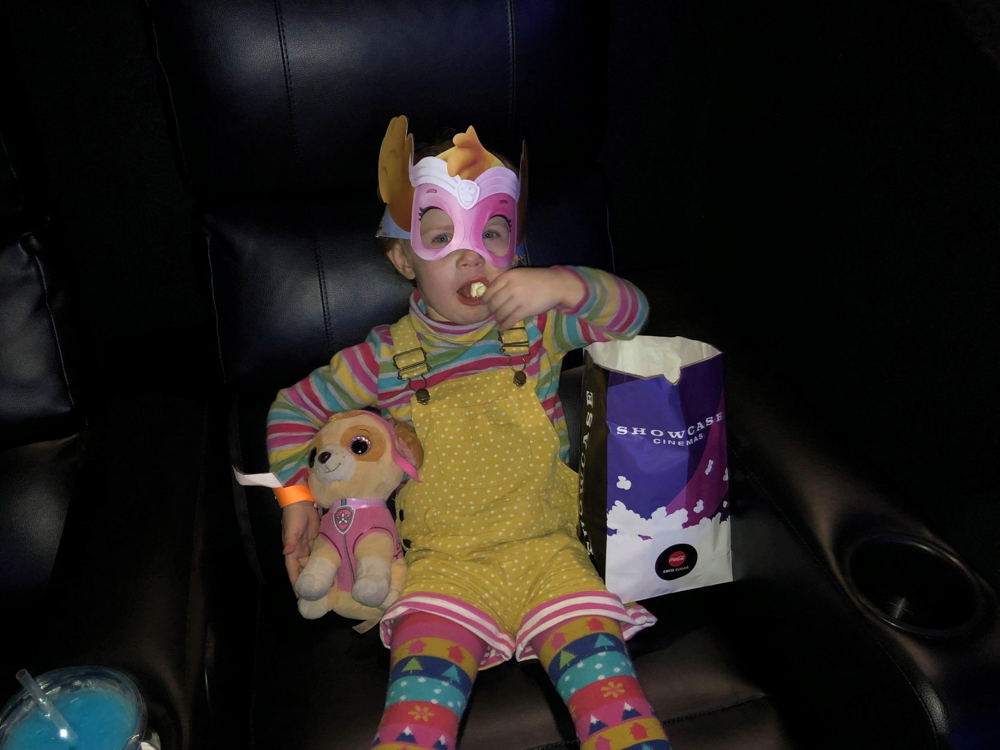 Toddler with Paw Patrol Skye eating popcorn at Showcase de Lux Bluewater