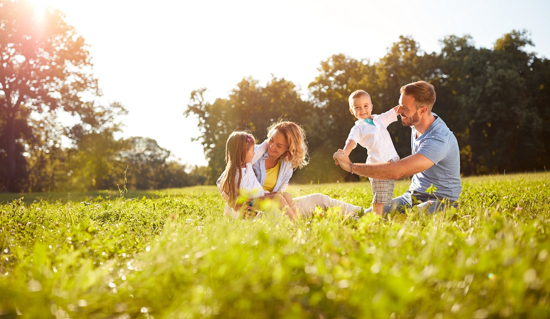 Family playing in the grass enjoying nature - asthma and hay fever