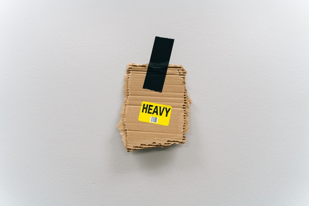 Heavy label on cardboard moving house box