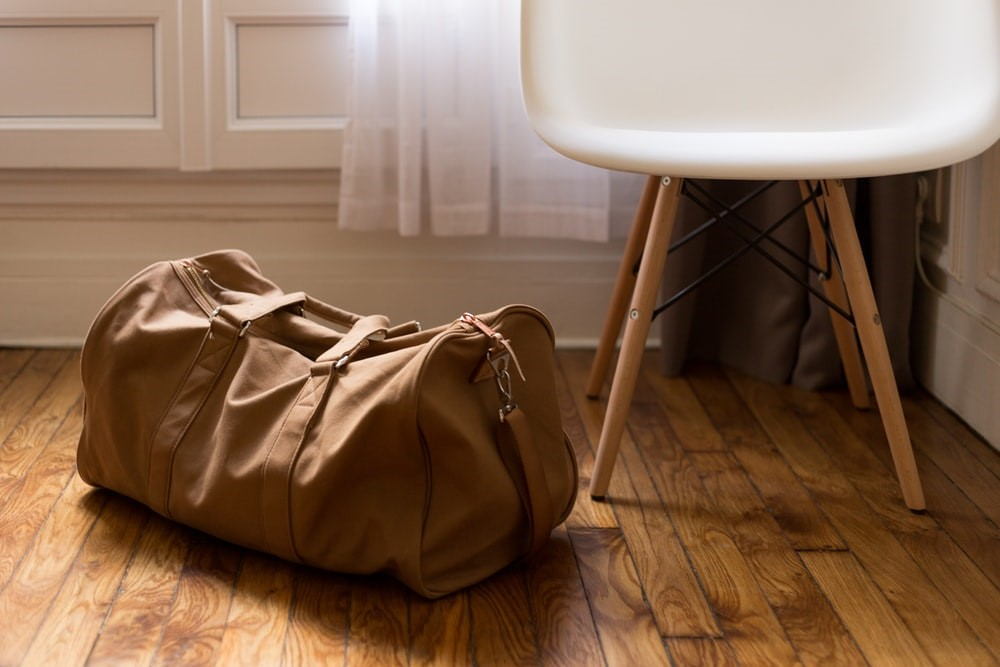 Large bag on floor next to chair