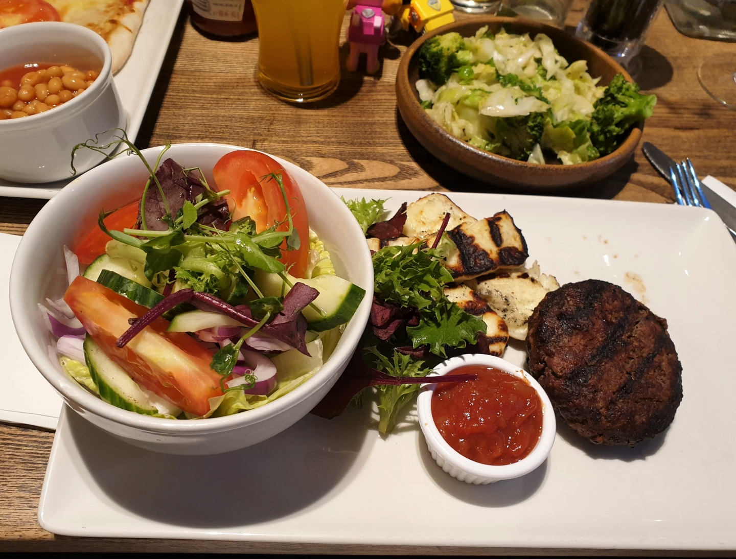 Waygu beef burger, salad and vegetables