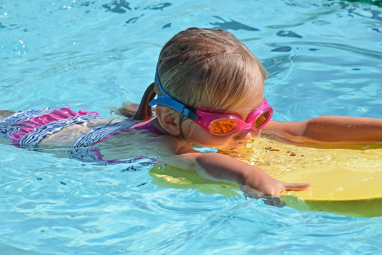young child swimming
