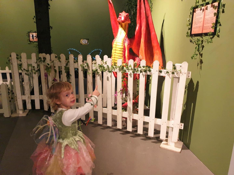 Toddler pointing at Enchanted Dockyard Dragon