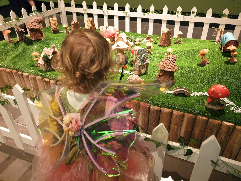 Child looking at Enchanted Dockyard fairy village, Chatham Dockyard