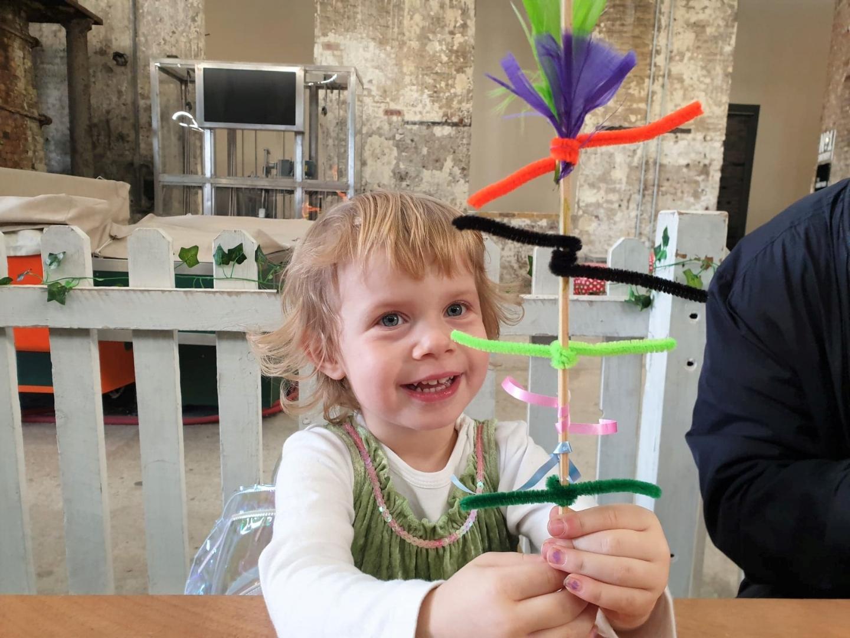 Toddler making magic wand at Chatham Dockyard, Enchanted Dockyard