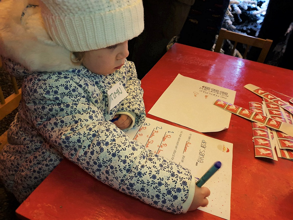 3 year old writing Christmas list to Father Christmas