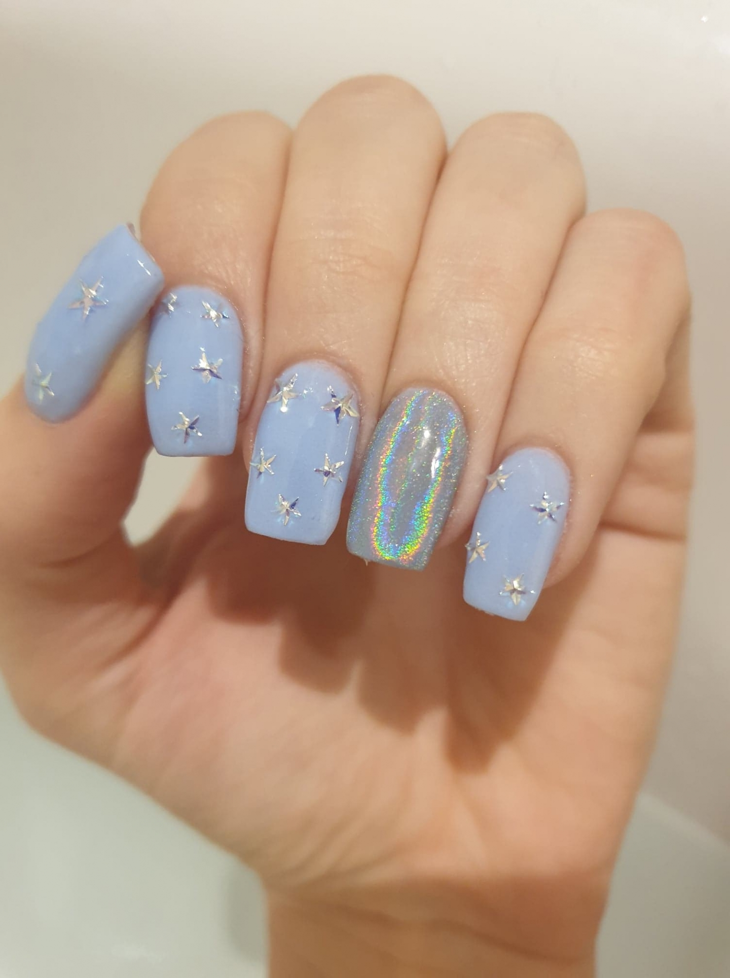 Blue star and holographic SNS nails manicure
