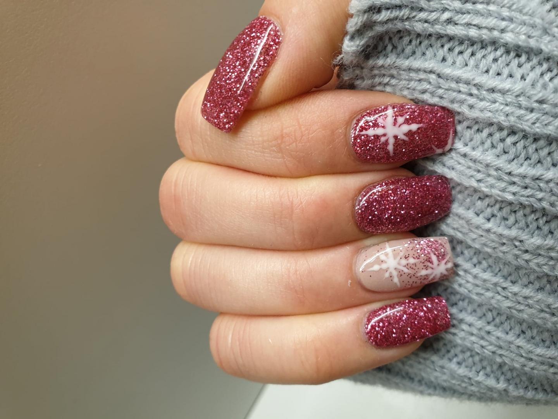 Glittery pink Christmas snowflake SNS nails