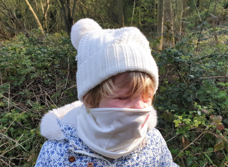Child wearing Virustatic Shield coronavirus COVID-19 snood face mask