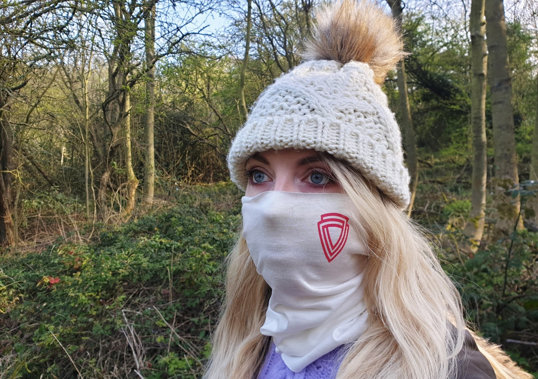 Woman wearing virustatic shield face mask to help prevent coronavirus