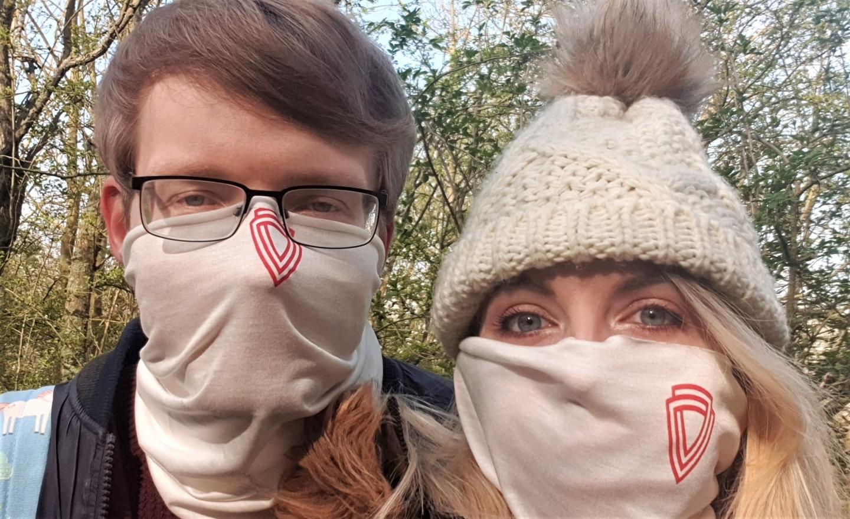 Couple wearing Virustatic Shield coronavirus COVID-19 flu face mask
