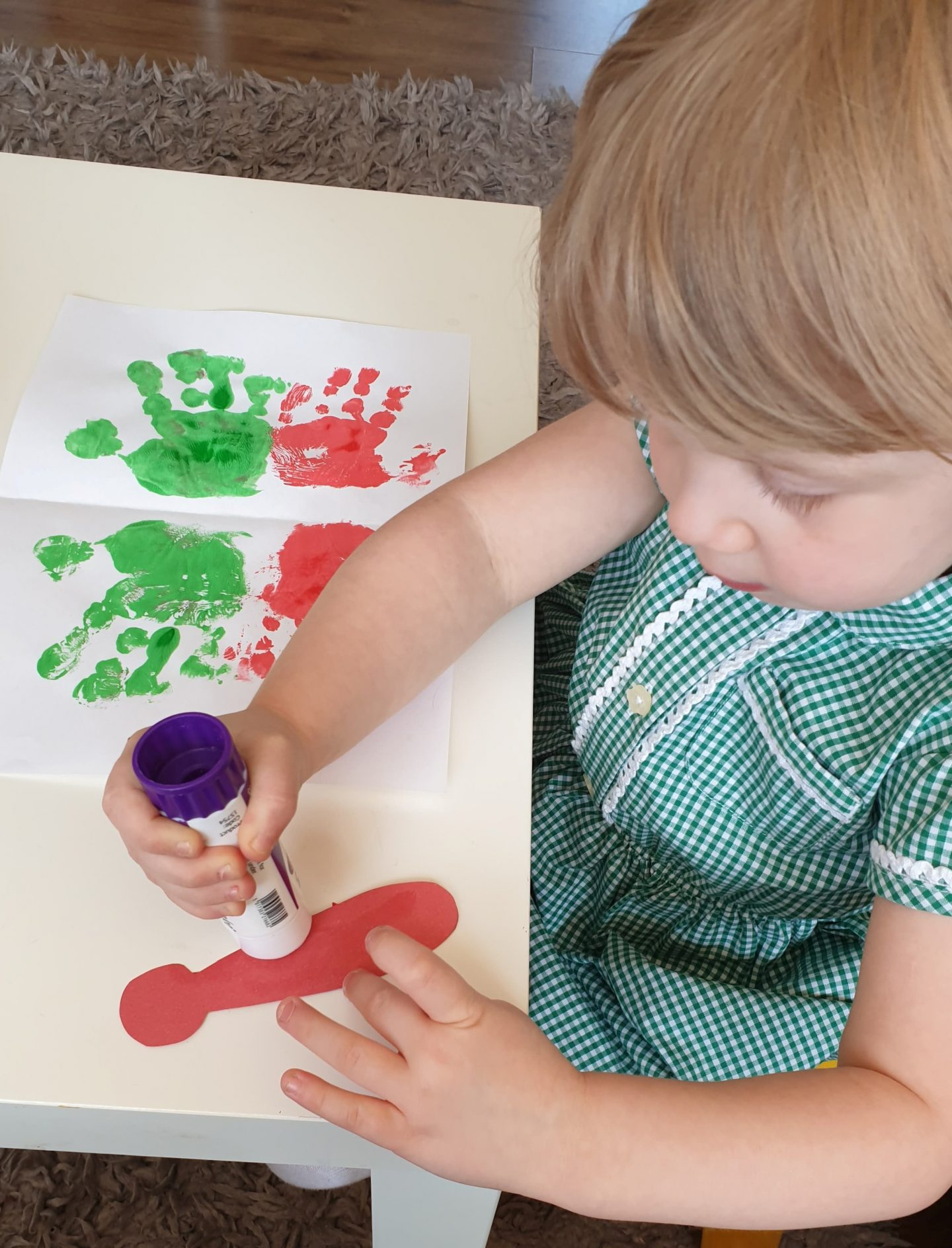 Toddler making hand print butterfly