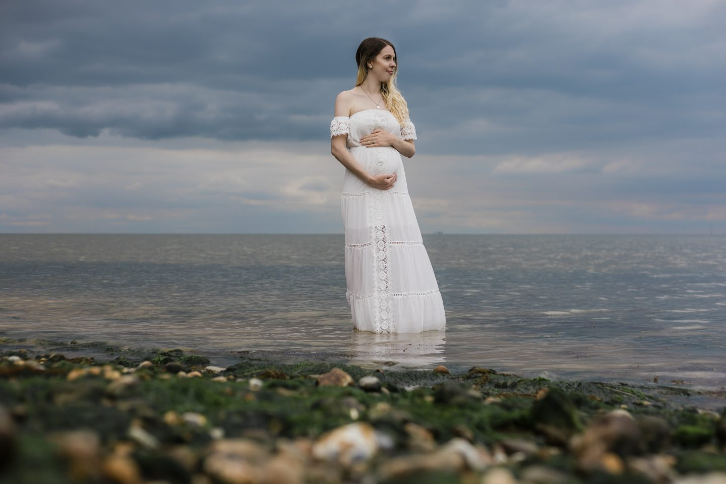 Boho sea pregnancy announcement photoshoot, rainbow baby after miscarriage by Robert Marriott