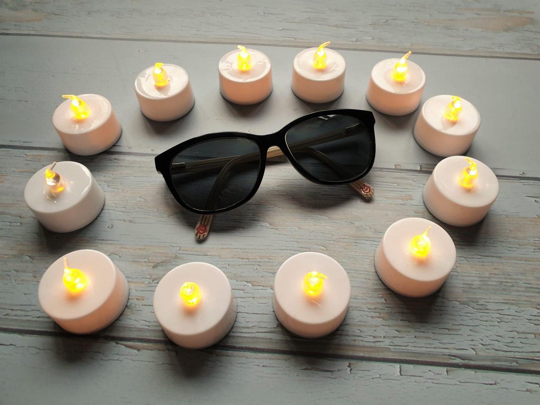 Sunglasses and tea lights